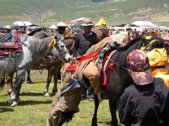 Tibetan horsemen at Lithang festival