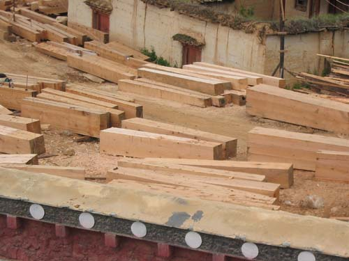 Massive timber pieces used in Tibetan architectural design