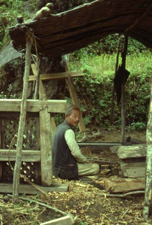 Local carpenter making traditional window